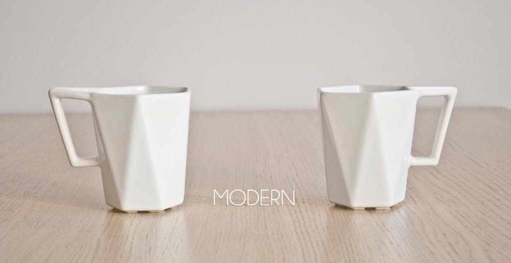 Dwa białe kubki Modern projektu Kabo&Pydo dla Avant Fabryka Porcelitu