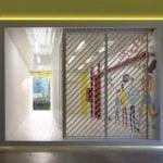 Żółte elementy w akademiku projektu Silp Architects