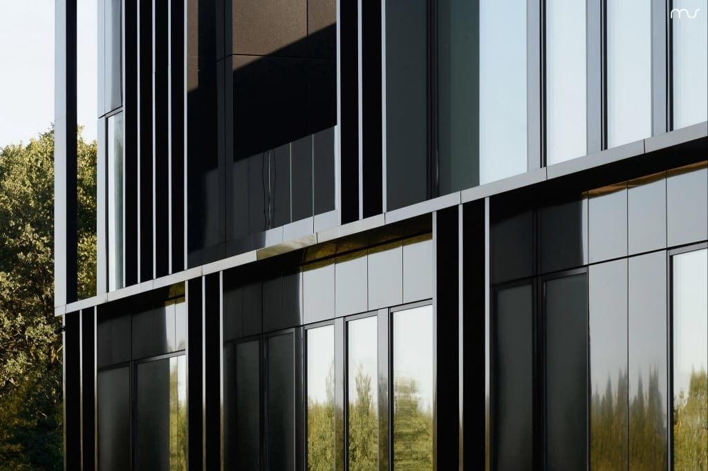 Czarny front z dużymi oknami w siedzibie firmy Pivexin Technology projektu pracowni Mus Architects