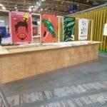 Kolorowe plakaty na wystawie Projektanci Roku Arena Design 2019