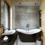 Szara łazienka z biało-czarną wanną projektu HOLA Design