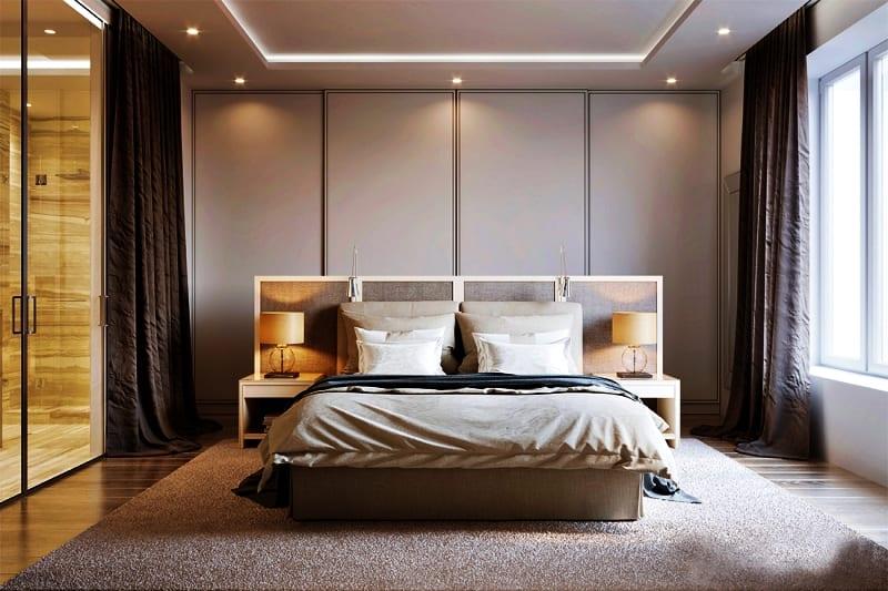 Sypialnia w beżowych kolorach z dużym łóżkiem
