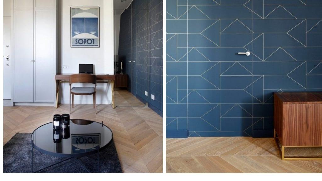Niebieska ściana i drewniana podłoga w mieszkaniu projektu Sojka & Wojciechowski