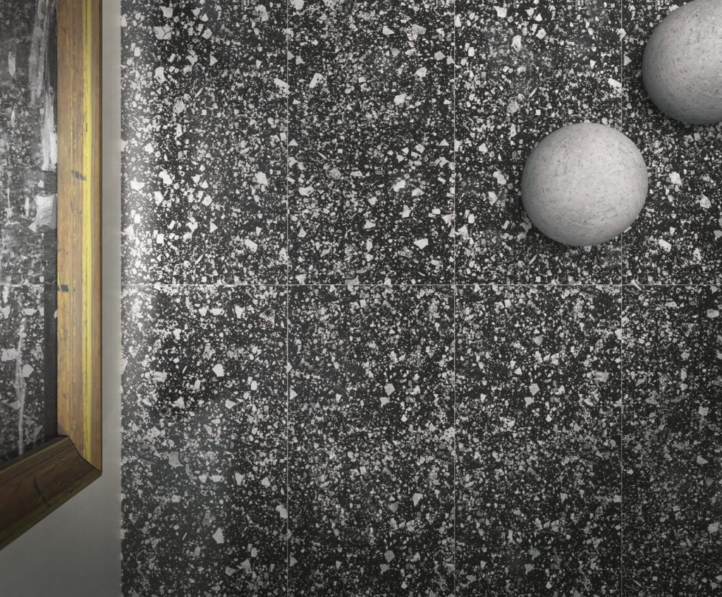 Czarna podłoga z lastryko w białe kropki