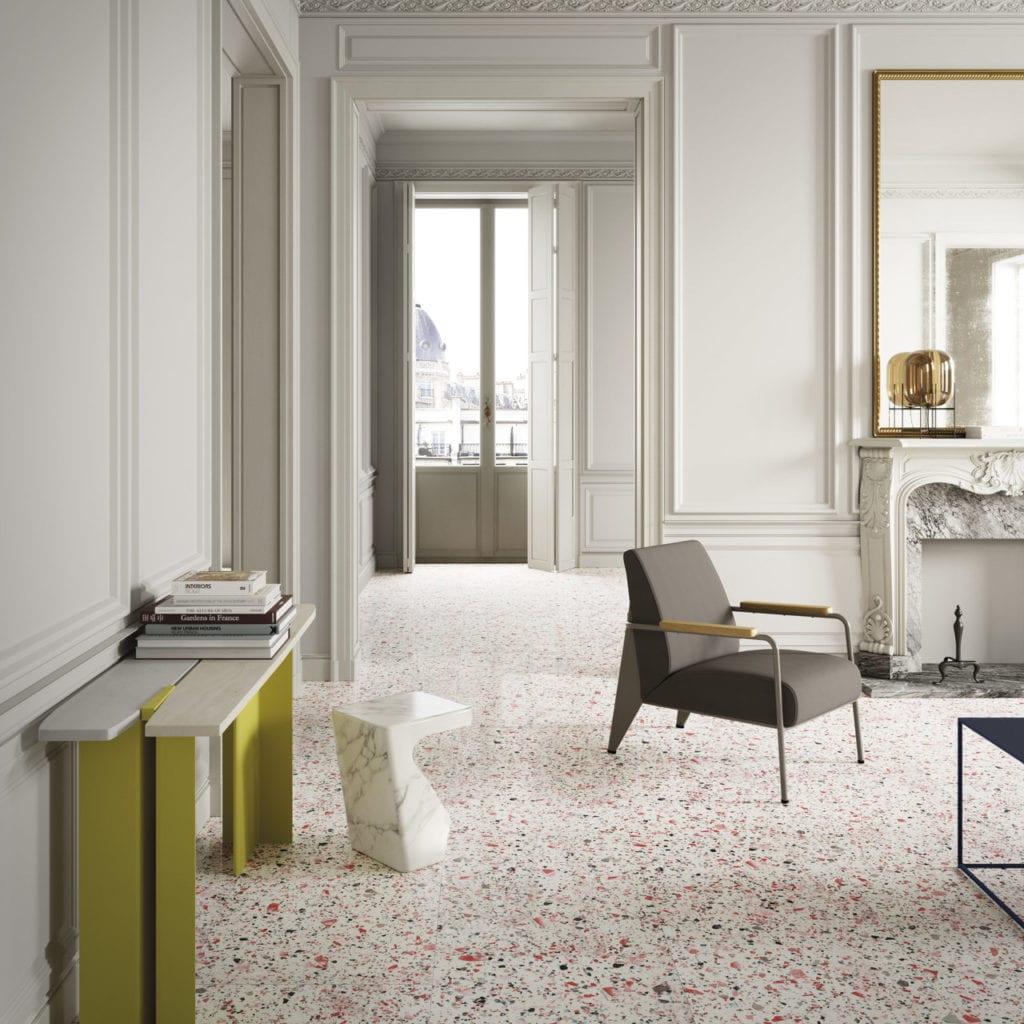 Pokój z białymi ścianami i podłogą z lastryko