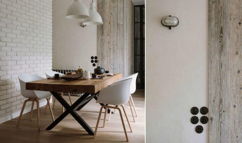 Jadalnia z dużym drewnianym stołem w mieszkaniu dla pary z dwójką dzieci projektu Studio O