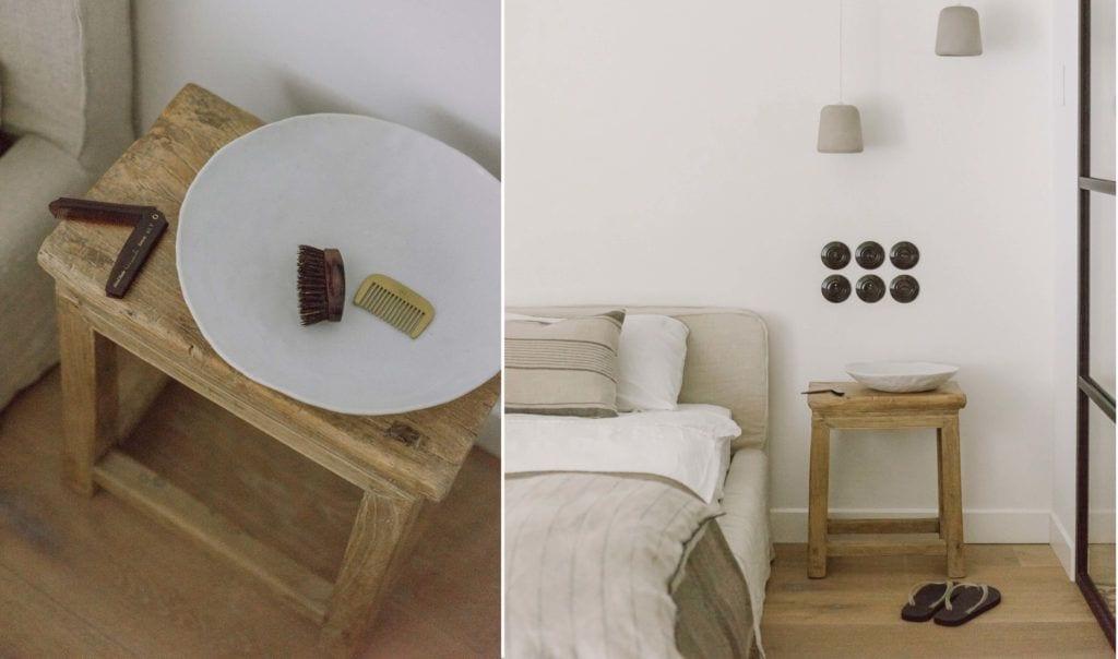 Duże łóżko i drewniany stolik nocny w mieszkaniu projektu Studio O