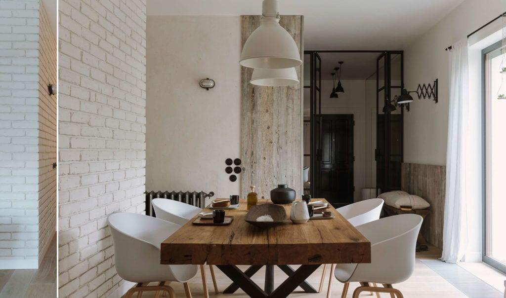 Duży drewniany stół w jadalni w mieszkaniu dla pary z dwójką dzieci projektu Studio O