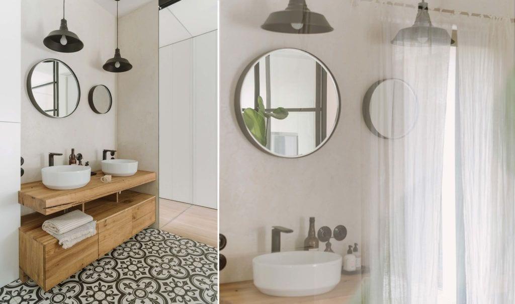 Dwa lustra w łazience zamontowane nad umywalkami