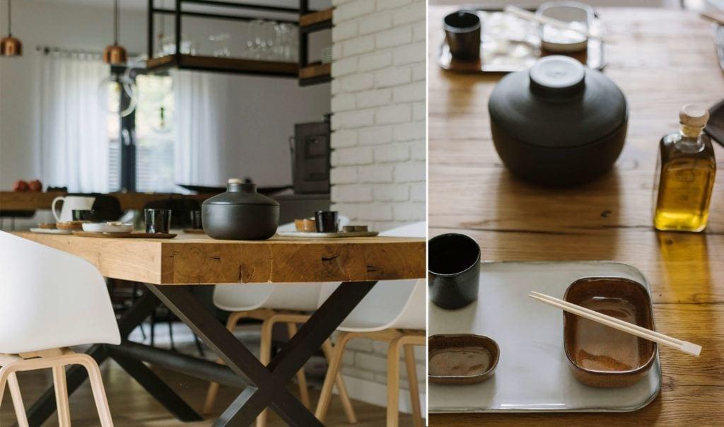 Jadalnia z drewnianym stołem i białymi krzesłami w mieszkaniu dla pary z dwójką dzieci projektu Studio O