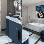 Szafka łazienkowa z niebieskim frontemw modernistycznej willi na Saskiej Kępie