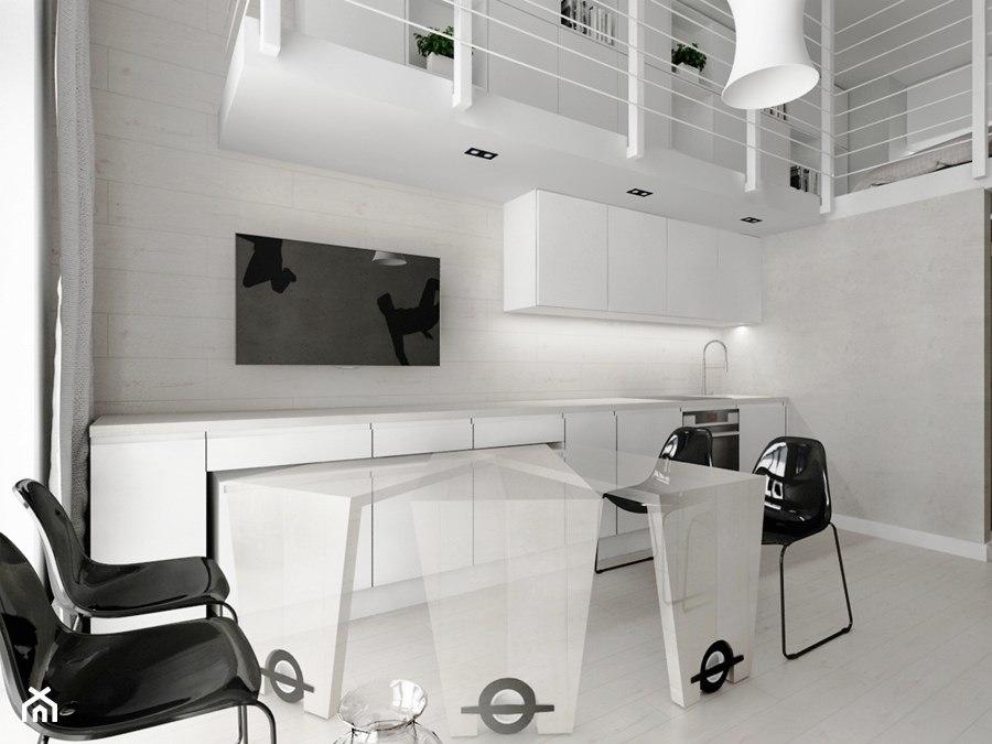 Biała kuchnia z czarnymi dodatkami - projekt Piotr Skorupski Studio Architektury