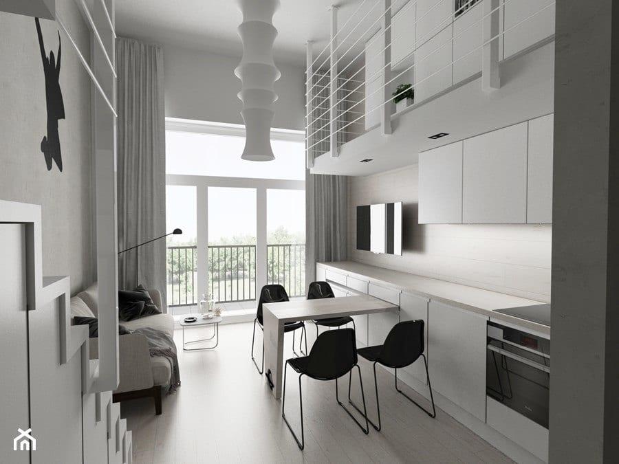 Biała kuchnia z czarnymi krzesłami - projekt Piotr Skorupski Studio Architektury