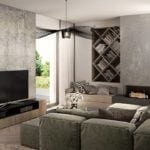 Salon w domu Corner House z drewnianą podłogą i zieloną sofą