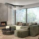 Zielona kanapa w salonie domu Corner House projektu pracowni 3DPROJEKT