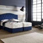 ome&Hotel Solutions - niebieskie wezgłowia łózka Opes #1