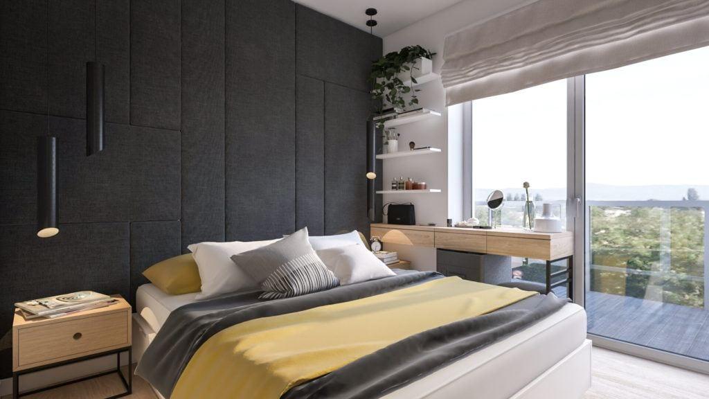 Sypialnia z szarą ścianą w łódzkim mieszkaniu projektu Marty Ogrodowczyk i Marty Piórkowskiej