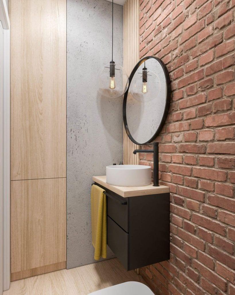 Łazienka z okrągłym lustrem w łódzkim mieszkaniu projektu Marty Ogrodowczyk i Marty Piórkowskiej