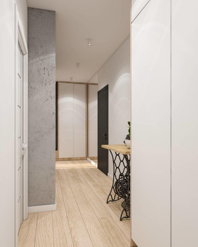 Hol z drewnianą podłogą w łódzkim mieszkaniu projektu Marty Ogrodowczyk i Marty Piórkowskiej