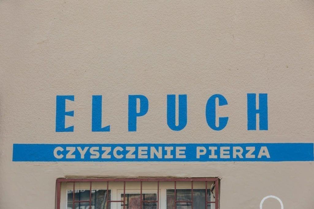Nowe szyldy na ulicach Elbląga inicjatywa DobryZnak - Elpuch czyszczenie pierza
