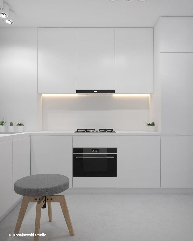 Jasna kuchnia w kawalerce Soft Loft projektu Kosakowski Studio