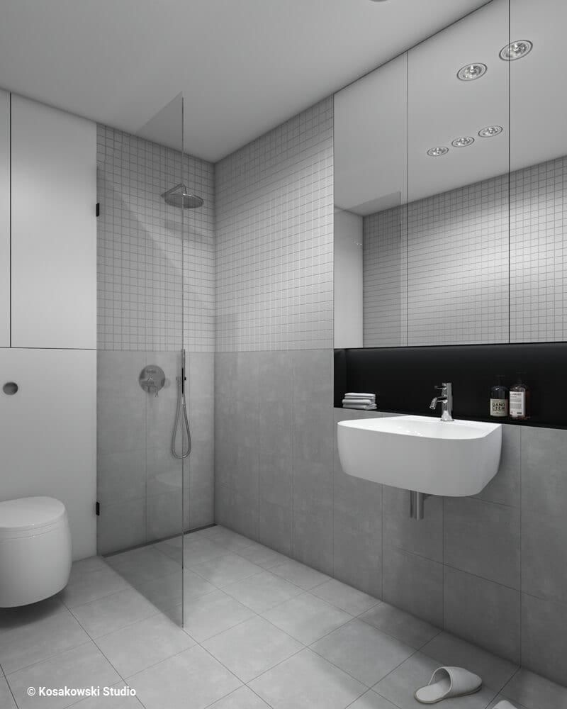Łazienka z kabiną w kawalerce Soft Loft projektu Kosakowski Studio