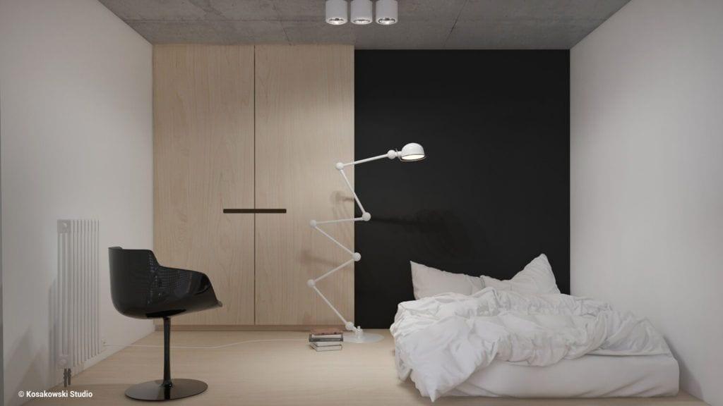 Salon z czarną ścianą w kawalerce Soft Loft projektu Kosakowski Studio
