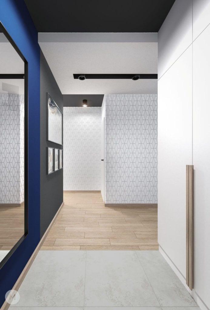 Nowoczesne mieszkanie na warszawskiej Ochocie projektu pracowni PROJEKT M - jasny hol z niebieską ścianą