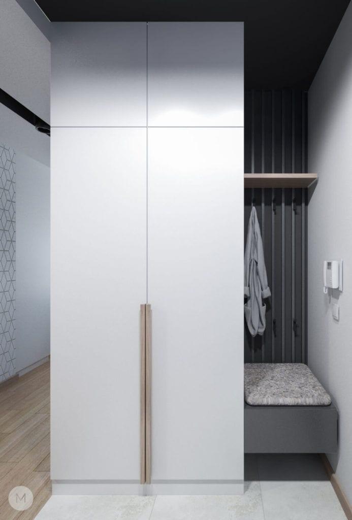 Nowoczesne mieszkanie na warszawskiej Ochocie projektu pracowni PROJEKT M - szafa z białymi drzwiami