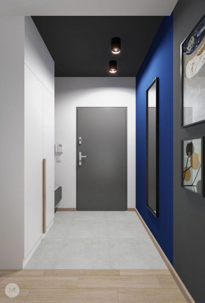 Nowoczesne mieszkanie na warszawskiej Ochocie projektu pracowni PROJEKT M - niebieska ściana w przedpokoju