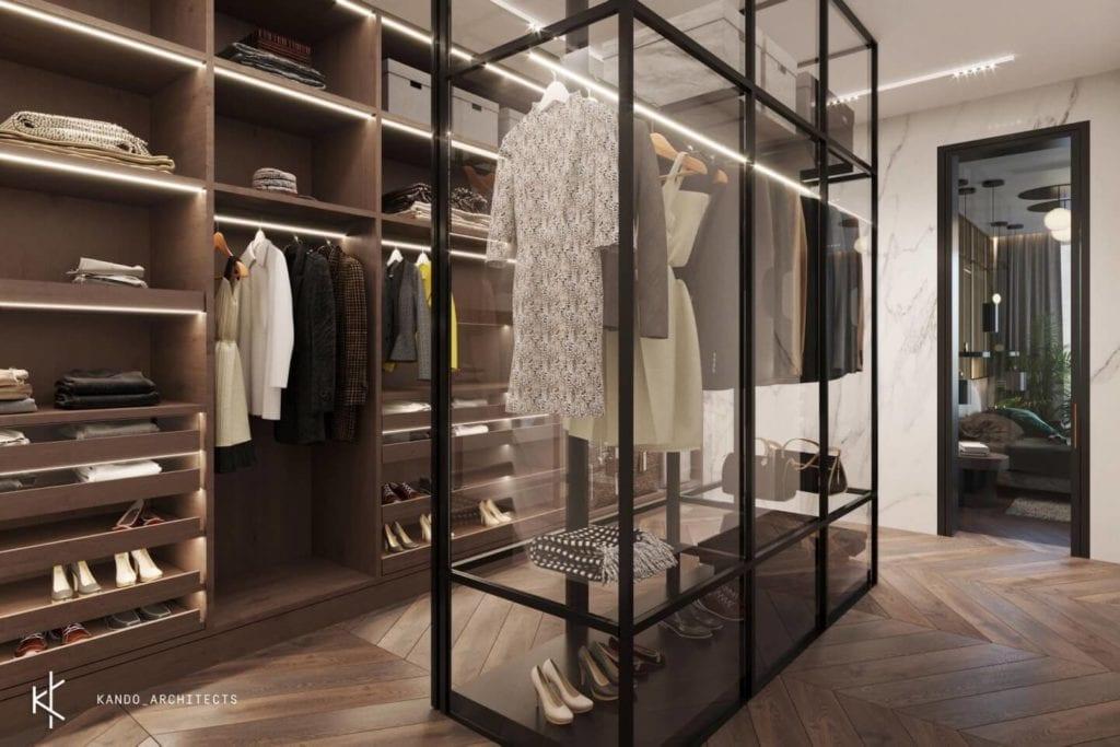 Stylowe wnętrza apartamentu projektu Kando Architects - Apartament z wdziękiem - garderoba w ciemnych kolorach