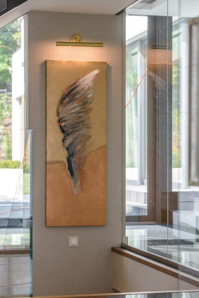 Obrazy Alicji Domańskiej w luksusowym domu zaprojektowanym przez pracownię Arte Dizain