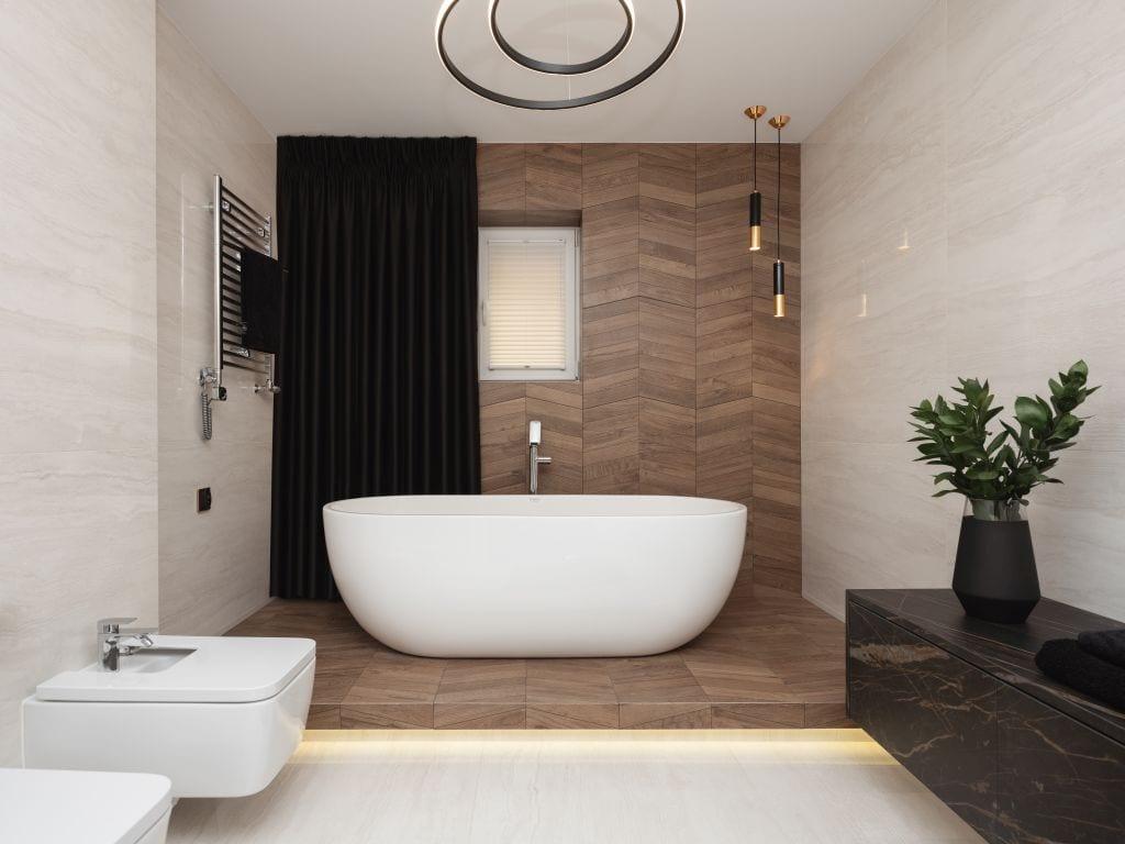 Kaza Interior Design i mieszkanie w Suchedniowie - łazienka z dużą wanną wolnostojącą