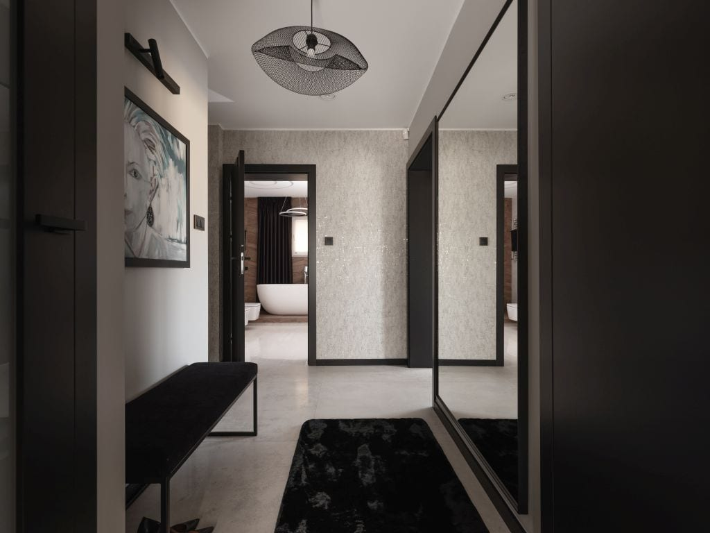 Jasny, przestronny hol mieszkania zaprojektowany przez architektów z pracowni Kaza Interior Design