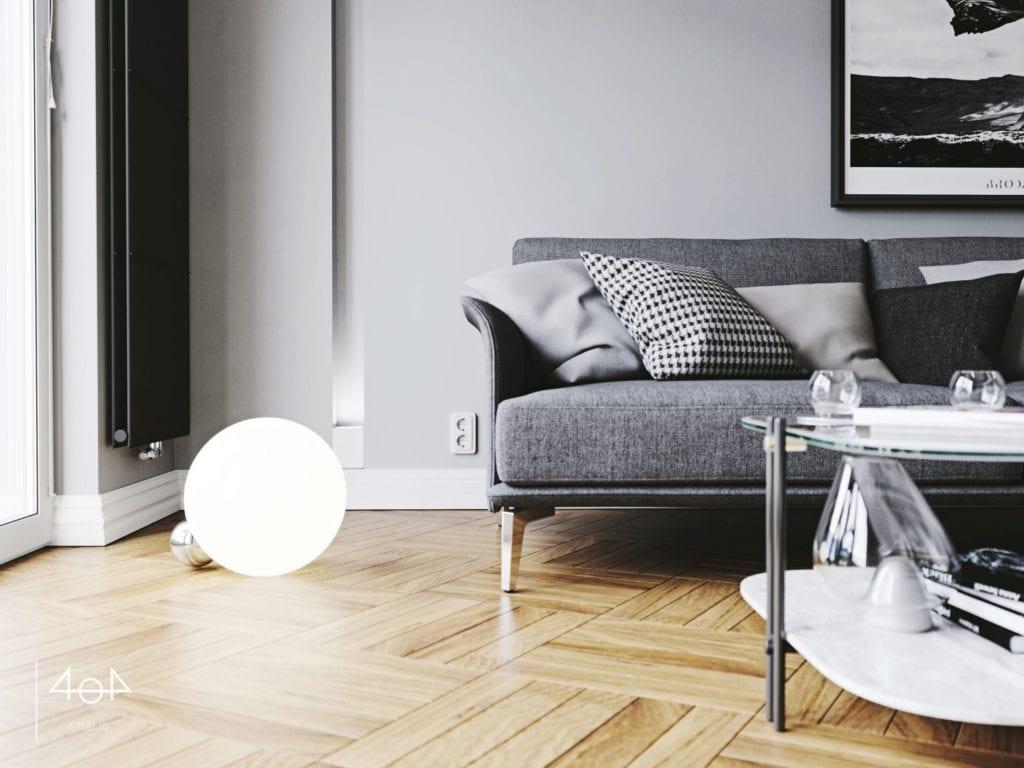 Minimalistyczny projekt mieszkania i drewniana podłoga w salonie