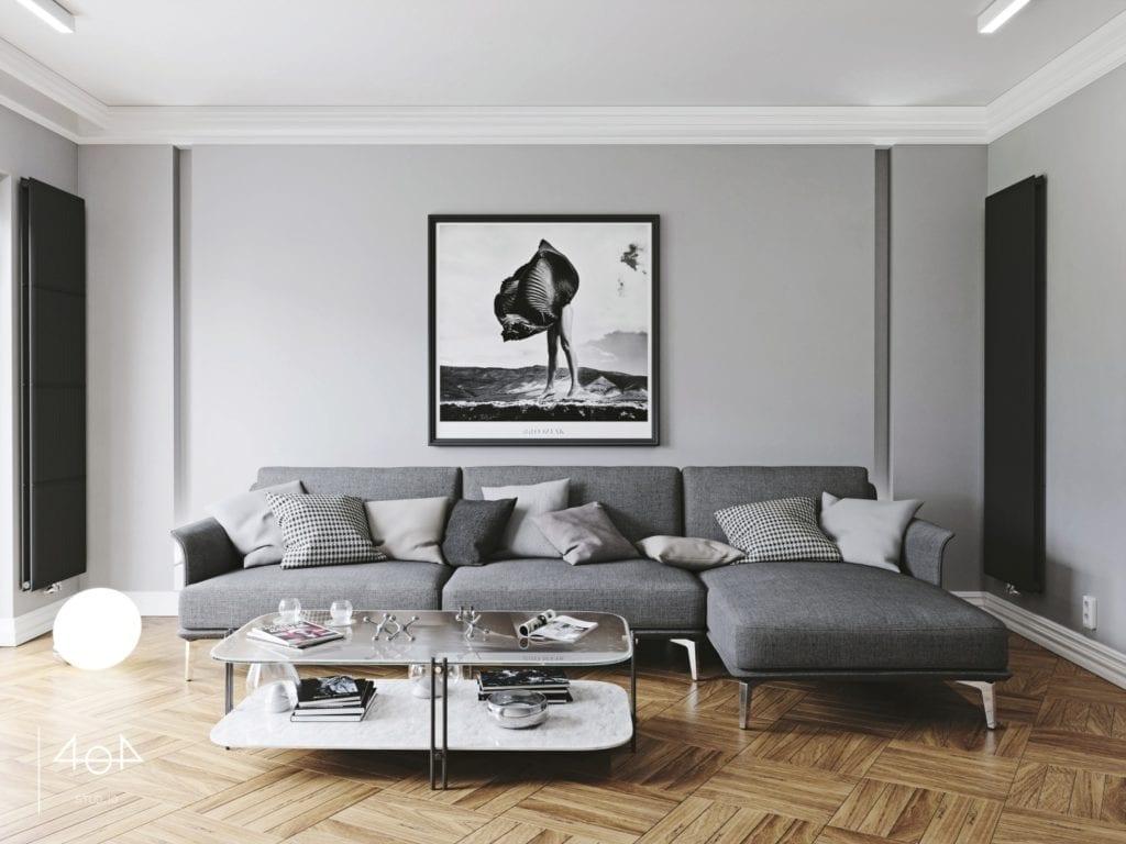 Minimalistyczny projekt mieszkania i szary narożnik i piękny obraz w salonie z drewnianą podłogą