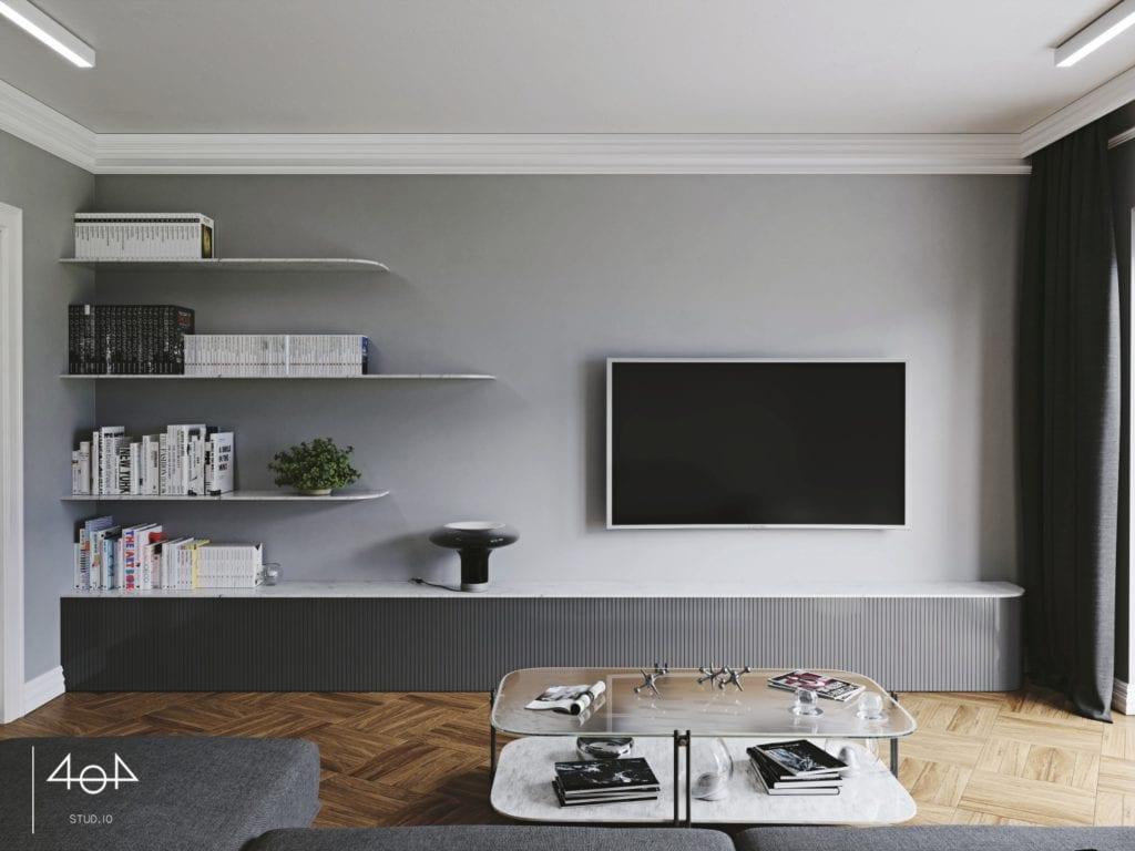 Minimalistyczny projekt mieszkania i telewizor wiszący na szarej ścianie w salonie