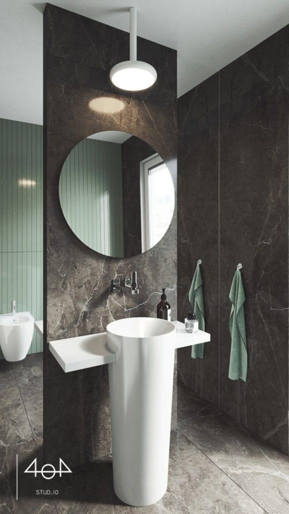 Minimalistyczny projekt mieszkania i czarna łazienka z okrągłym lustrem