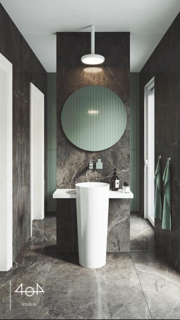 Minimalistyczny projekt mieszkania i okrągłe lustro w czarnej łazience