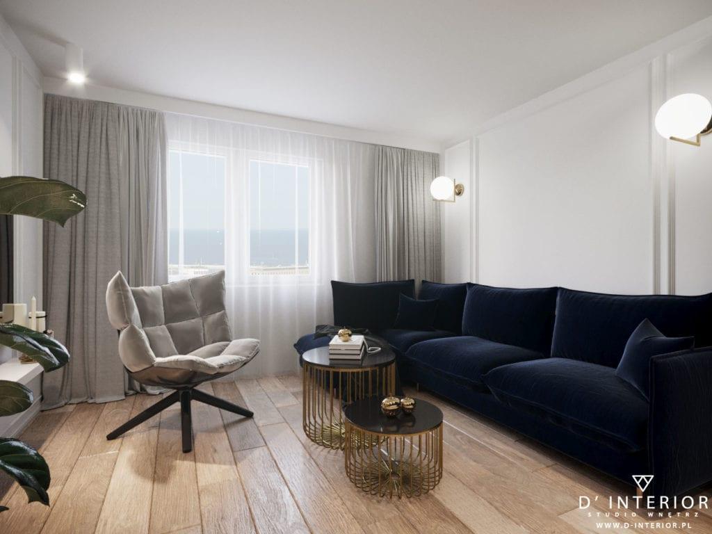 D'INTERIOR i projekt mieszkania na wynajem - granatowa sofa w salonie