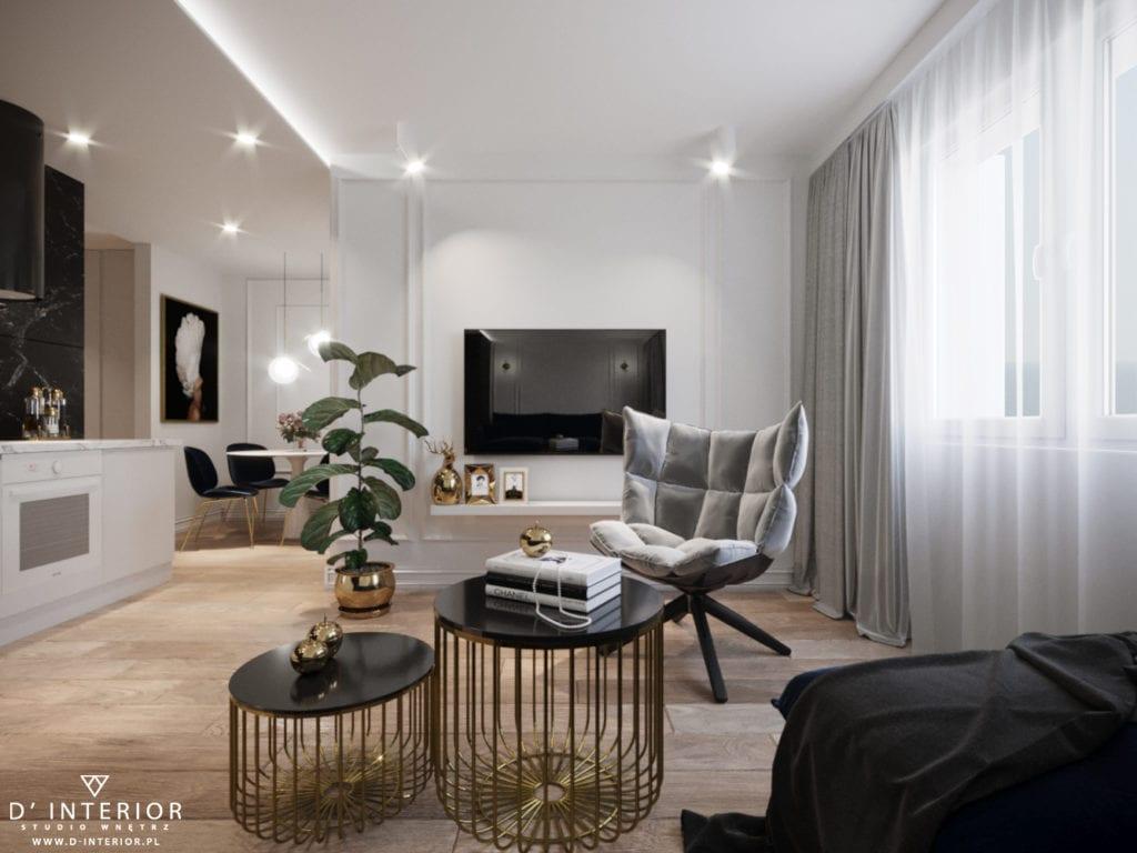 D'INTERIOR i projekt mieszkania na wynajem - przestronny salon z dużym fotelem
