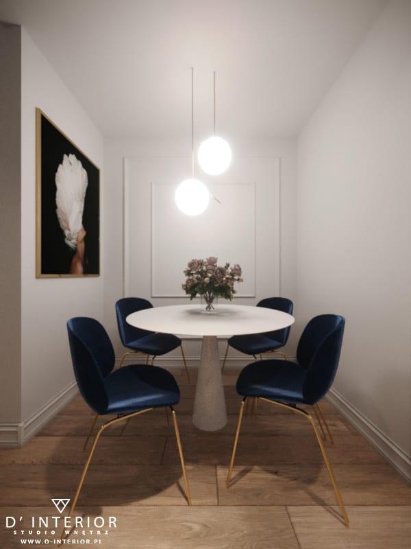 D'INTERIOR i projekt mieszkania na wynajem - okrągły stolik i cztery granatowe krzesła