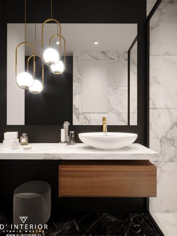 D'INTERIOR i projekt mieszkania na wynajem - jasna łazienka z ciemnymi detalami