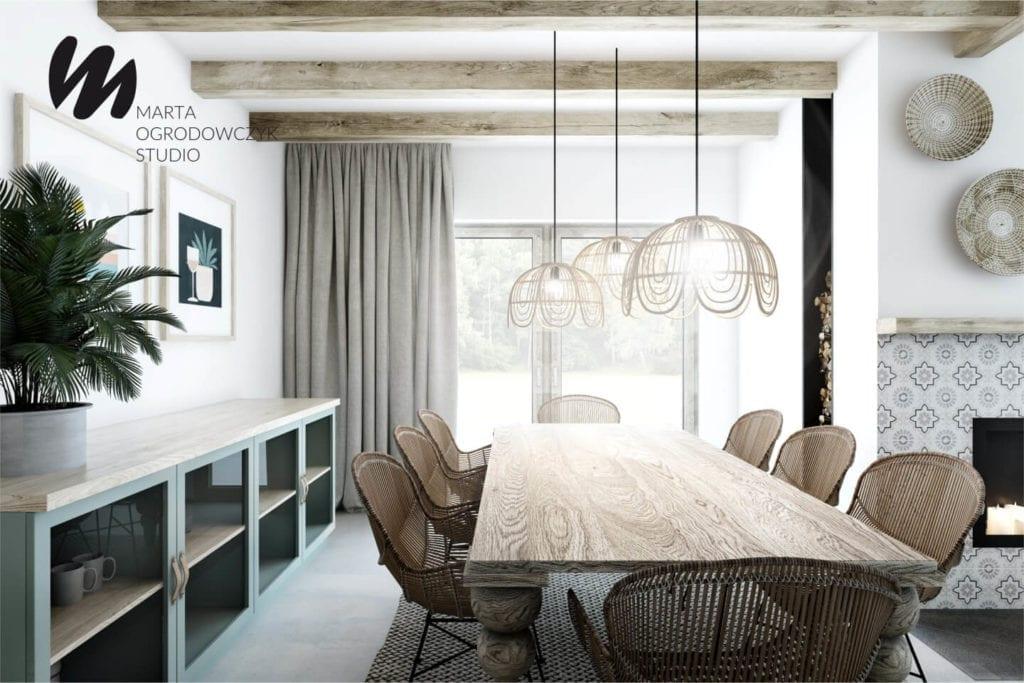 Ciepłe wnętrze w stylu boho projektu Marta Ogrodowczyk Studio - drewniany stół w salonie