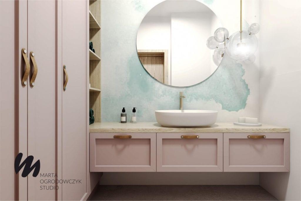 Ciepłe wnętrze w stylu boho projektu Marta Ogrodowczyk Studio - okrągłe lustro w łazience