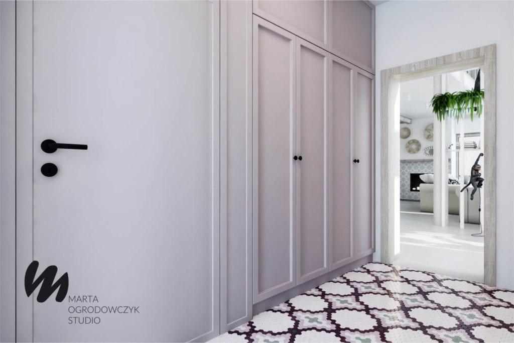 Ciepłe wnętrze w stylu boho projektu Marta Ogrodowczyk Studio - szafa w przedpokoju