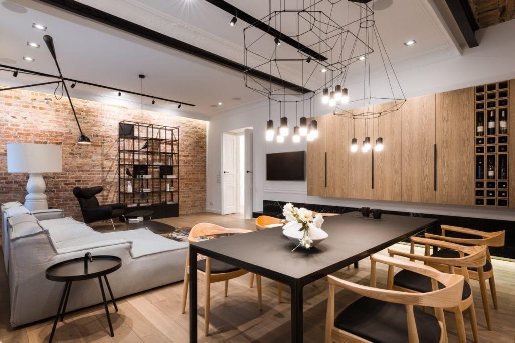Nasciturus design i drugie życie mieszkania w kamienicy - salon w ciemnych kolorach