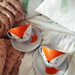 Filiżanka Muki z modelu Rudy lis w kolorze pomarańczowo białym z porcelany