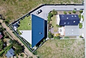 RE: TRIANGLE HOUSE – dom na planie trapezu od REFORM Architekt