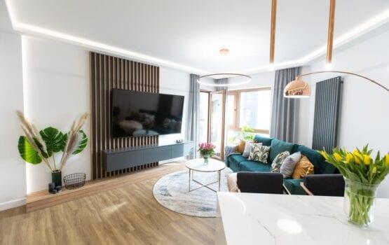 Eleganckie i funkcjonalne wnętrza 60-metrowego mieszkania w Kielcach
